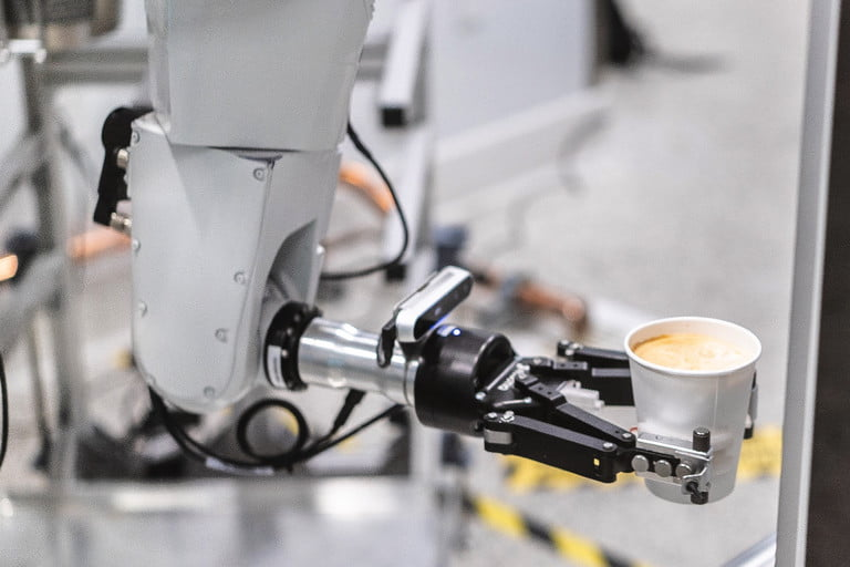 robotic arm serves morning coffee quickly